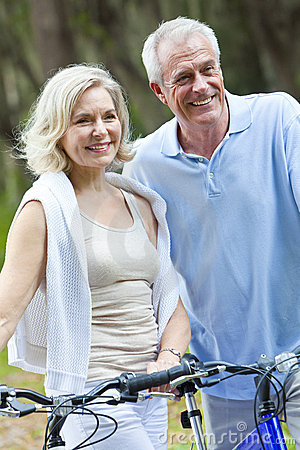 Free Happy Senior Man & Woman Couple Cycling Bicycles Stock Images - 21827054