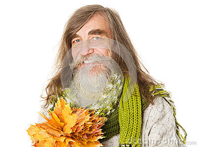 Happy Senior old man holding autumn yellow maple leaves