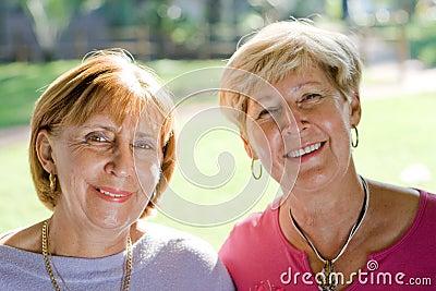 happy senior sisters & friends