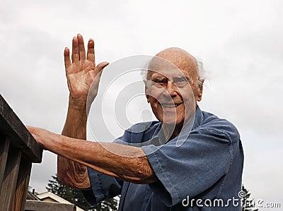 Happy Senior Waving Outside