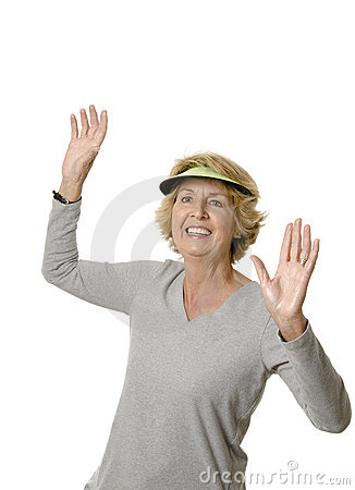 Happy senior woman with arms raised