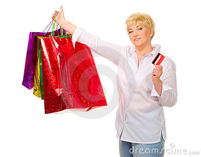 Happy senior woman with bags and credit card