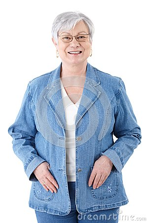 Happy senior woman in denim jacket smiling