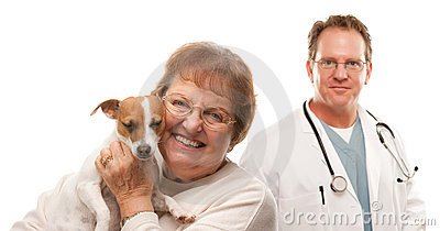 Happy Senior Woman with Dog and Male Veterinarian