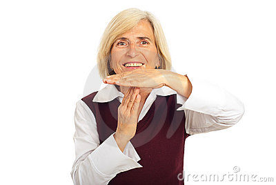 Happy senior woman gesture time out