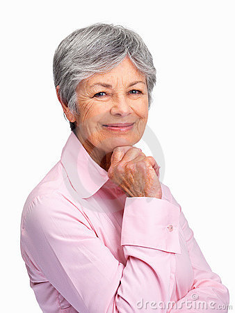 Happy senior woman with hand on chin