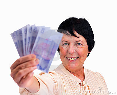 Happy senior woman holding fan of money