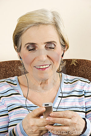 Happy senior woman listen to music