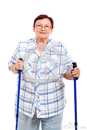 Happy senior woman with walking sticks