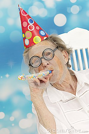 Free Happy Senior Woman With Funny Glasses A Party Hat And A Noise Maker Royalty Free Stock Photos - 39273218