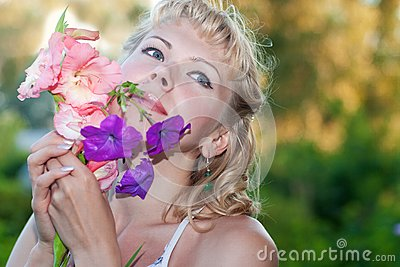 Happy sensual woman with  flowers
