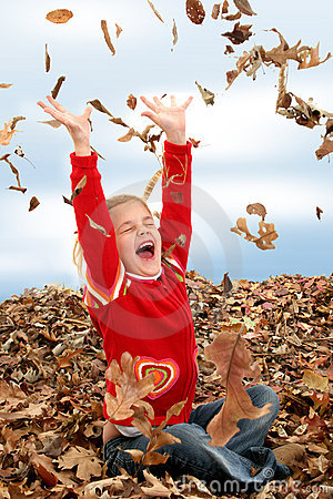 Free Happy Seven Year Old Girl Playing In Pile Of Leaves Stock Photography - 393792