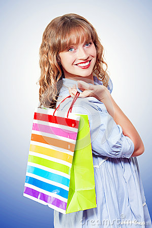 Happy shopaholic returning with her purchases