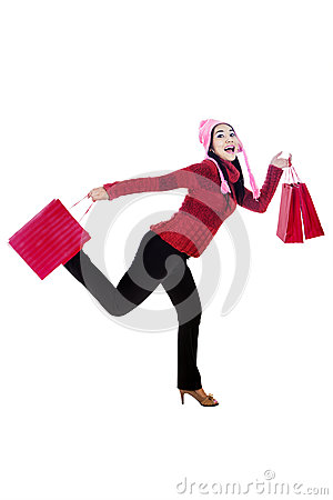 Happy shopper isolated in white
