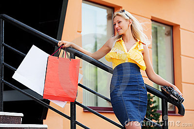Happy fashion woman with shopping bags at the mall