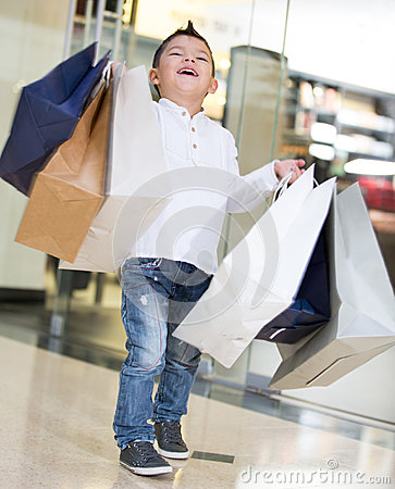 Happy shopping boy