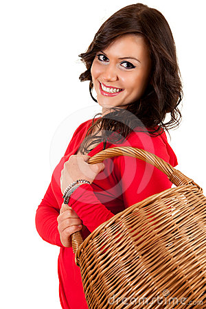 Happy shopping girl with wicker basket