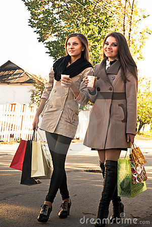 Happy Shopping: Two Girls drinking coffee or tea