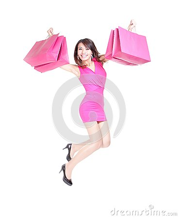 Happy shopping young woman jumping