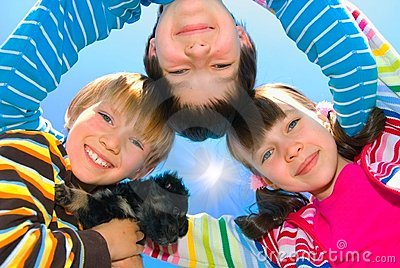 Happy siblings and dog