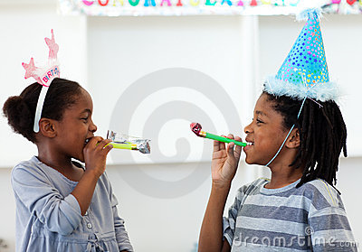 Happy siblings having fun at a birthday party