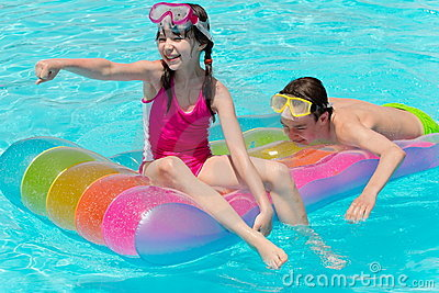 Happy siblings on raft