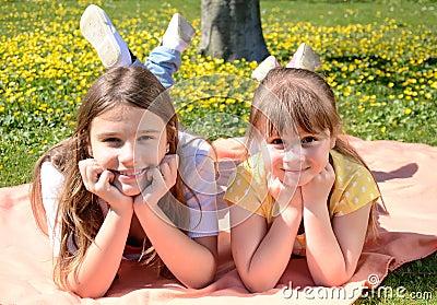 Happy sisters in spring park