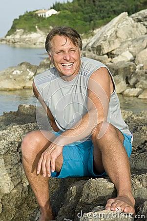Happy sitting on a rock