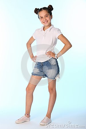 Free Happy Slender Child Girl Full Growth In Denim Shorts With Bare Legs Stock Image - 112284551
