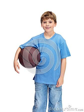 Happy small boy holding basket ball