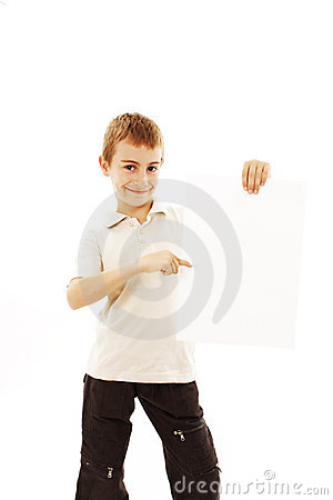 Happy small boy holding a blank board