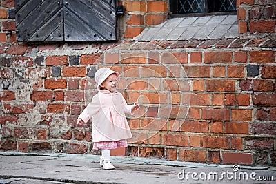Happy small girl moving forward