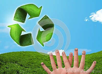 Happy smiley fingers looking at green leaf recycle sign Stock Photo