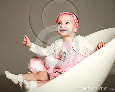Happy smiling baby infant in the studio