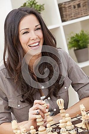 Happy Smiling Beautiful Woman Playing Chess
