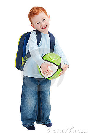Happy smiling boy child with ball and school bag
