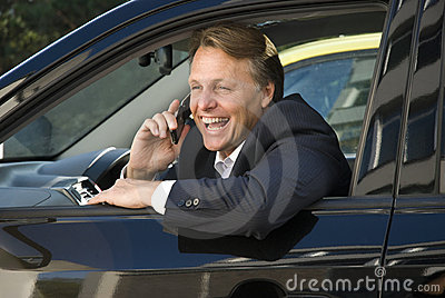 Happy smiling businessman on phone