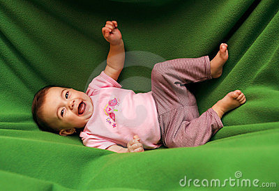 Happy smiling child on blanket