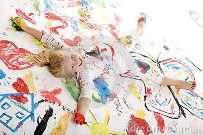 Happy smiling child full with color (paint)