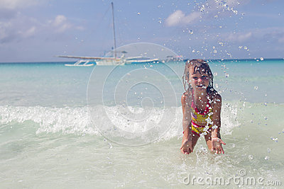 Happy smiling child girl in water