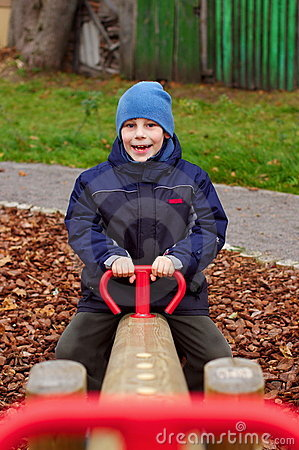 Happy smiling child in playground vertical
