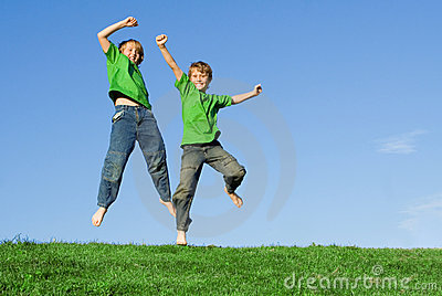 Happy smiling children jumping