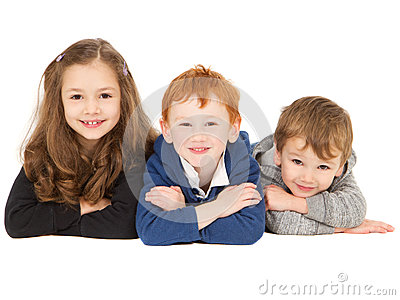Happy smiling children laying in group