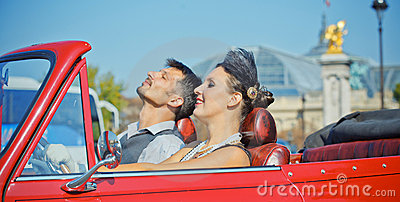 Happy smiling couple in a car. Romance in Paris.