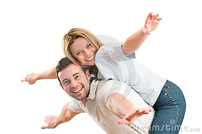 Happy smiling couple piggyback arms outstretched