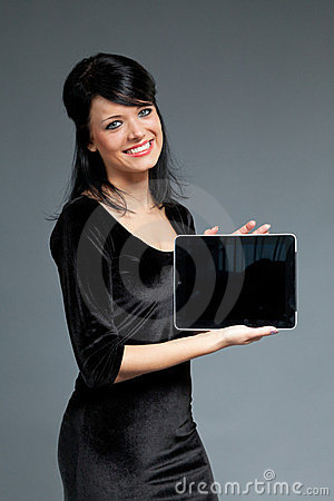 Happy smiling cutie with touch pad empty screen