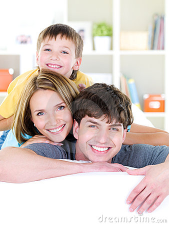 Happy smiling faces of young family