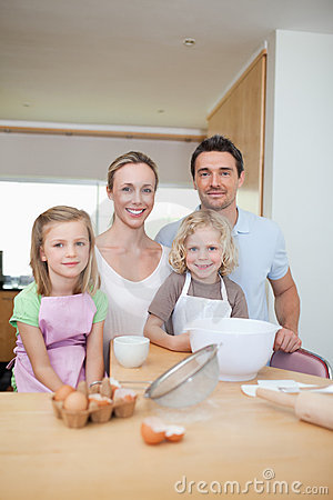 Happy smiling family preparing cookies