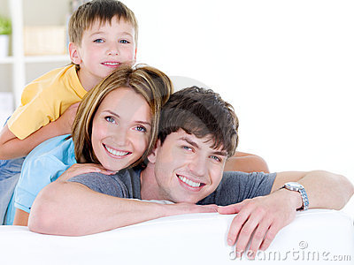 Happy smiling family of three people