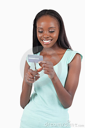 Happy smiling female destroying credit card